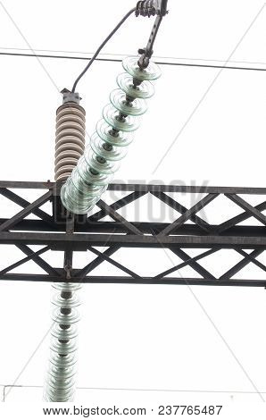 High-voltage Electrical Insulator Electric Line. Glass Insulators On Wires