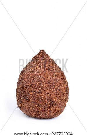 closeup of a kibbeh, a levantine dish, on a white background