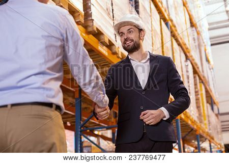 Pleasant Meeting. Delighted Positive Businessman Smiling While Greeting His Worker