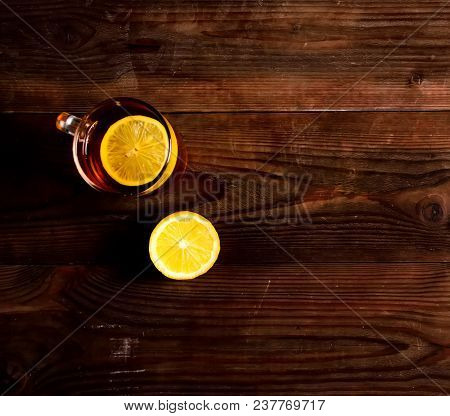 Cup Of Tea With Lemon On A Wooden Background.hot Drink For Cold. Top View.flat Lay.