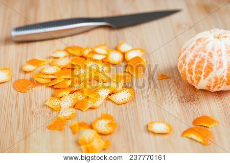 Tasty And Healthy Zest Of Fresh Mandarin On A Wooden Table Close-up