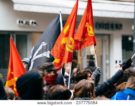 Strasbourg, France  - Mar 22, 2018: Young Communist Flags In Hands At Demonstration Protest Against
