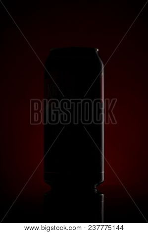 Silhouette Of A Beer Can On A Dark Red Background Drink Concept Very Beautiful