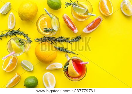 Concept Of Alcoholic Cocktail With Fruits. Glass With Beverage Near Oranges, Grapefruit, Lime And Ro