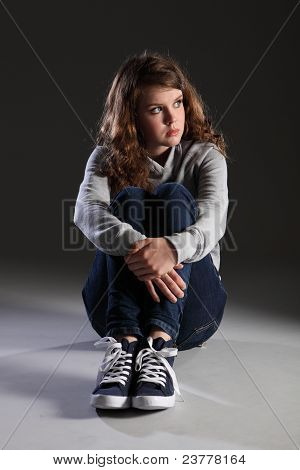 Sad Depressed Young Teenager Girl Sitting Alone