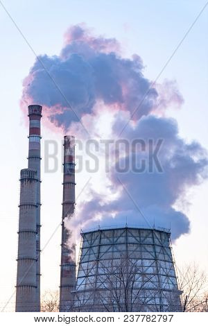 Smoke From Factory Pipes Against The Sky. Environmental Pollution