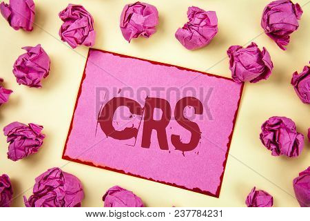 Writing Note Showing  Crs. Business Photo Showcasing Common Reporting Standard For Sharing Tax Finan