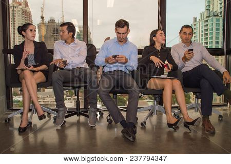 Business Concepts. Young Business People Is Playing Mobile. Business People Are Contacting Customers