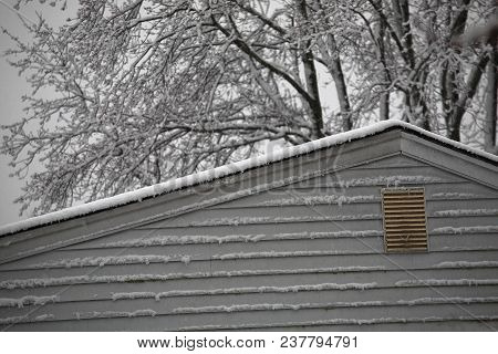 Snow On The Roof - Snowy Day Rooftop Of A Suburban House.