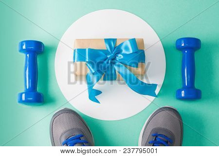 Holiday, Birthday, Party Sport Flat Lay Composition With Blue Dumbbells, Gray Shoes On White Round C