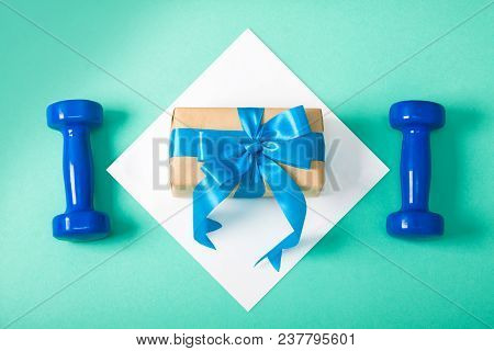 Holiday, Birthday, Party Sport Flat Lay Composition With Blue Dumbbells Gift Box On White Square Cya