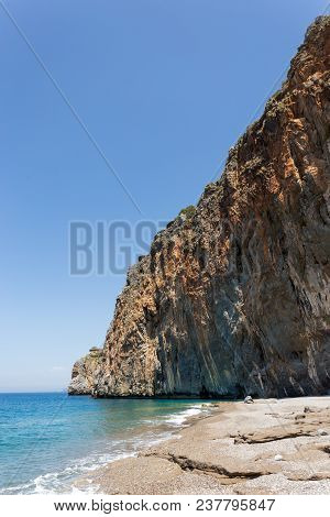 Summer Travel Concept. Landscape With The Beautiful Beach With Rocky Shore. Vertical Composition. Co