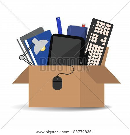 Office Accessories In A Cardboard Box Isolated On A White Background. There Is A Keyboard, A Monitor