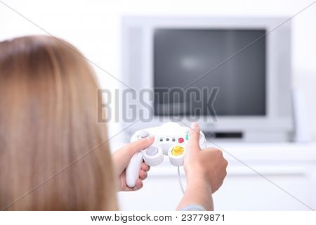 Teenager on games console