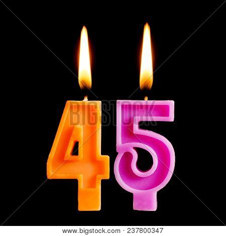 Burning Candles In The Form Of 45 Forty Five Figures (numbers, Dates) For Cake Isolated On Black Bac