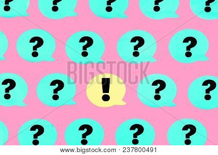 Turquoise Stickers With Question Marks On A Pink Background. In The Center Is A Yellow Sticker With