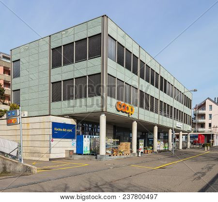 Ruschlikon, Switzerland - 2 April, 2018: Building Of The Coop Store On Weingartenstrasse Street In T