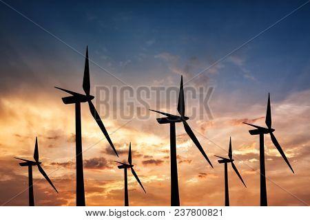 Eco energy.Windturbines at sunset