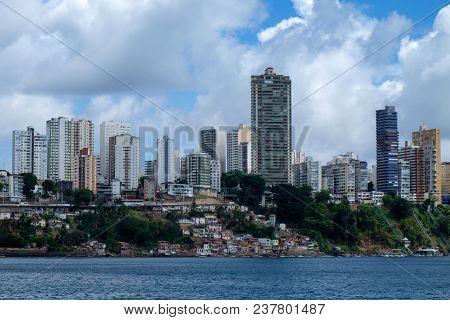 The Cityscape Of Salvador De Bahia, Brazil As Seen From The Ocean. A Big Contrast Between The Rich R
