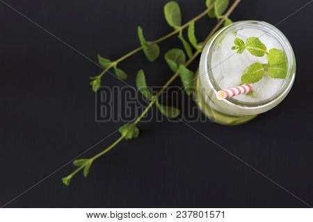 Mojito Cocktail With Ice, Lime And Mint On Dark Background. Top View