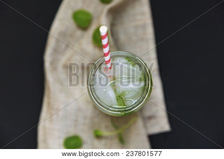Summer Drink With Ice, Lime And Mint On Dark Background. Top View. Closeup