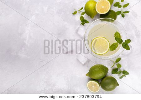 Mojito With Lime And Mint In A Glass On Grey Stone Background. Refreshing Cocktail, Copy Space Flat