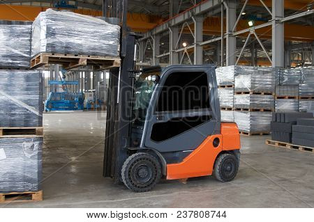Working Forklift In Warehouse. Forklift Loader Pallet Stacker Truck Equipment At Warehouse