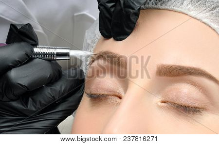 Microblading. Cosmetologist Making Permanent Makeup. Attractive Woman Getting Facial Care And Tattoo