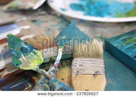 Macro of Artists Brushes and tools in Artists Studio with soft focus background