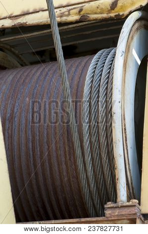 Close-up Crane Cable Drum. The Main Drum With Iron Wire On The Rail Crane.