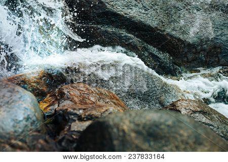 Waterfall Beautiful Waterfall In The Park Sapokka Finland. The Water Spray From The Waterfall Closeu