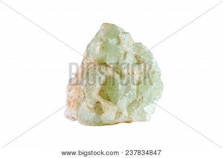 Macro Shooting Of Natural Gemstone. The Raw Mineral Is Prehnite. Isolated Object On A White Backgrou