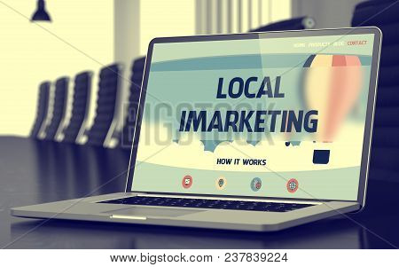 Local Imarketing. Closeup Landing Page On Mobile Computer Screen. Modern Conference Hall Background.