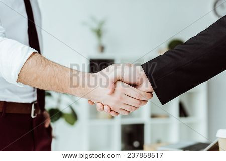 Cropped View Of Businesspeople Shaking Hands In Office