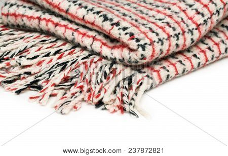 Checkered Woolen Plaid With Tassels Isolated On White Background, Close-up