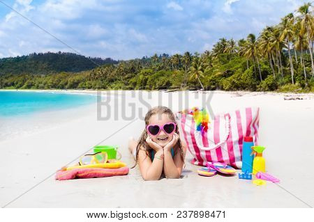 Child At Tropical Beach With Bag And Toys.