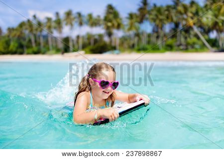 Kids Surf On Tropical Beach. Vacation With Child.