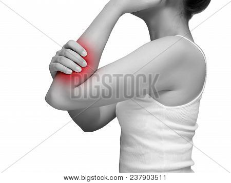 Woman Suffering From Arm Pain, Painful In Arm Muscles. Mono Tone Color With Red Highlight At Arm , A