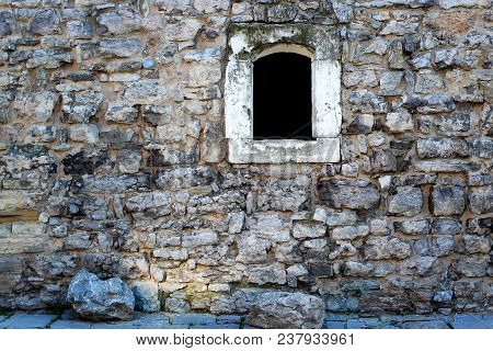 Old Wall With Jail Window At A Fortress In Barcelona
