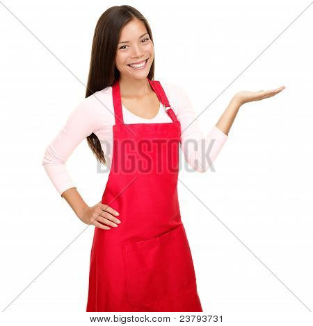 Small Shop Owner Showing In Apron