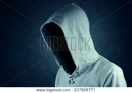 Faceless Unknown And Unrecognizable Person Without Identity Wearing  Hooded Jacket.