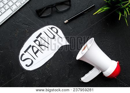 New Business, Start Up Concenpt. Megaphone Near Words Start Up In Cloud On Black Background Top View