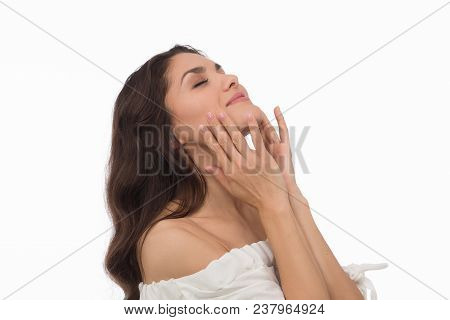 Luxury Brunette With Pefrect Skin Touching Her Face. Beauty Concept. Mid Age Woman Over 35 Years Old