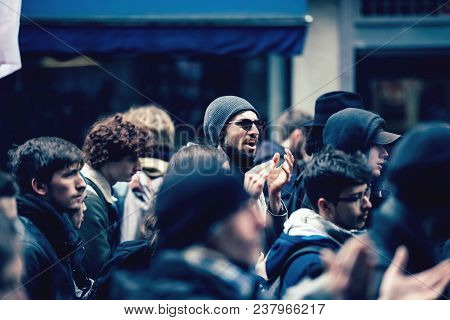 Strasbourg, France  - Mar 22, 2018: Man With Sunglasses In The Middle Of Crowd At Demonstration Prot