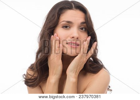 Portrait Of Attractive Brunette With Disapointed Face. Touching Her Face. Mid Age Woman Over 35 Year