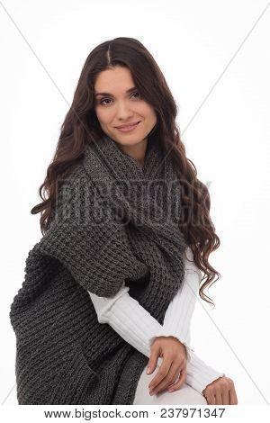 Portrait Of Brunette Woman Wearing Gray Cardigan. Stylish Female Model In Studio. Mid Age Woman Over