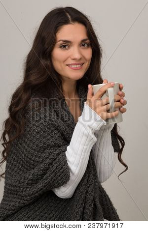 Female Brunette In Fashion Gray Cardigan Holding Big Cup Of Coffee. Mid Age Woman Over 35 Years Old