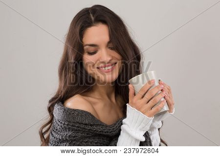 Nice Brunette Looking Down Holding Cup Of Coffee. Isolated On White Background. Mid Age Woman Over 3