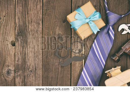 Fathers Day Side Border Of Gifts, Tie And Decor On A Rustic Wood Background. Top View, Vintage Styli