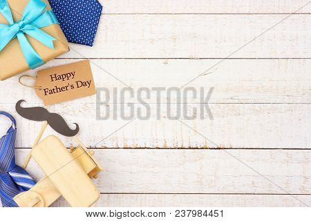 Happy Fathers Day Gift Tag With Side Border Of Gifts, Ties And Decor On A White Wood Background. Top